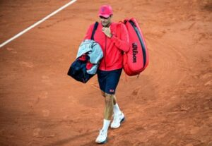 Roger Federer walks off court at the French Open.