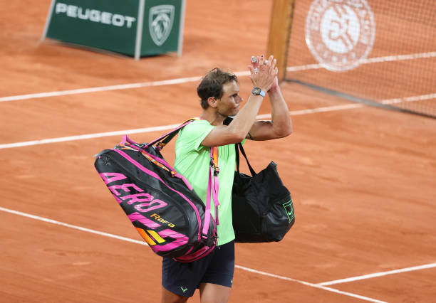 Rafael Nadal leaves the court after defeat at the French Open.