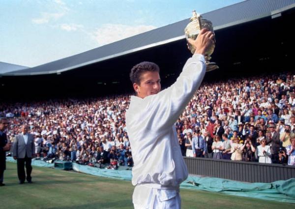Richard Krajicek holds the Wimbledon trophy aloft in 1996.