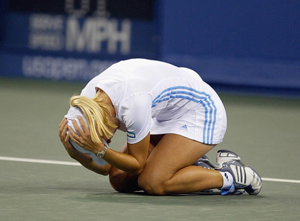 Justine Henin celebrates her victory in the 2003 US Open semifinal.