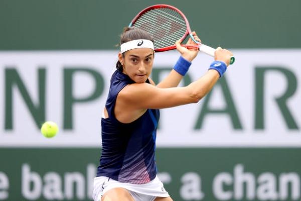 Caroline Garcia of France returns a shot to Kirsten Flipkens of Belgium during the BNP Paribas Open at the WTA Indian Wells Open.