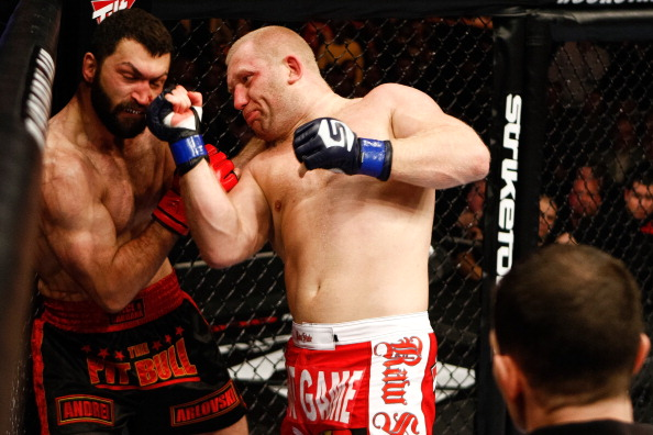 EAST RUTHERFORD, NJ - FEBRUARY 12: (R-L) Sergei Kharitonov punches Andrei Arlovski during their bout at the Strikeforce Heavyweights Grand Prix event at the Izod Center on February 12, 2011 in East Rutherford, New Jersey. (Photo by Esther Lin/Zuffa LLC/Zuffa LLC via Getty Images)