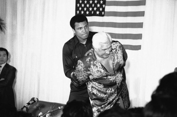 """Ali with his manager for his 1976 fight with Inoki, """"Classy"""" Freddie Blassie (Photo: PInterest.com)"""